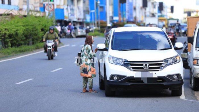POPULER - Perda Ketertiban Umum, Siap-siap Pemberi dan Peminta di Jalanan Kena Denda Rp 500 Ribu