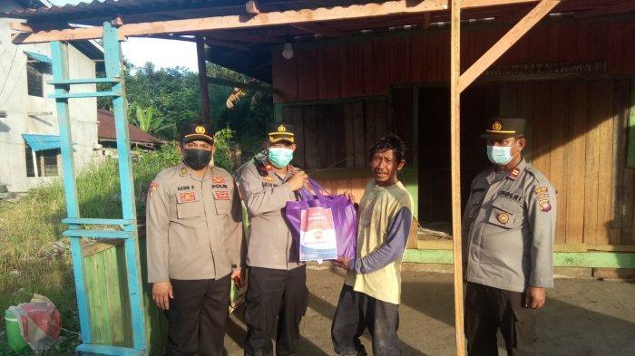 Polres Melawi Salurkan 150 Paket Sembako serta Imbau Warga Agar Patuhi Ketentuan PPKM dan Prokes