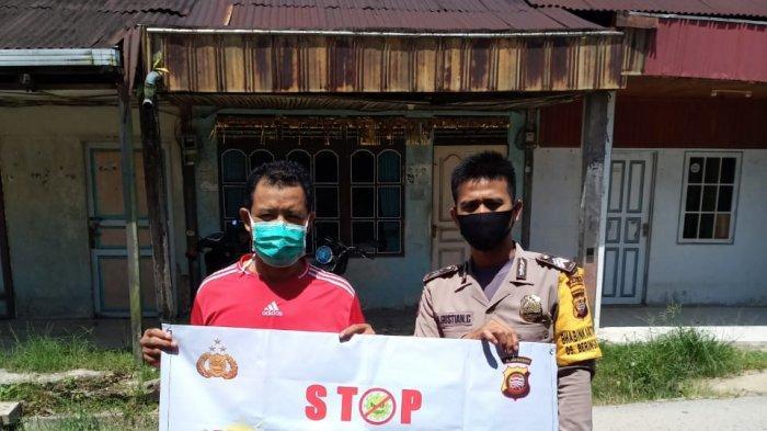 Personel Polsek Monterado Sampaikan Imbauan Tidak Mudik Hari Raya Idul Fitri 1442 H