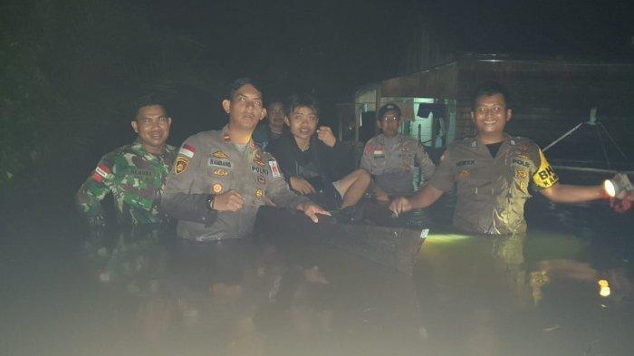 Turun ke Lokasi Banjir di Desa Cupang, Ini Imbauan Kapolsek Meliau