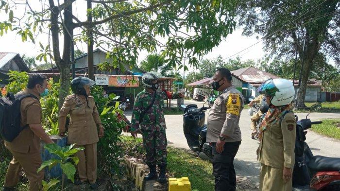 Bhabinkamtibmas, Babinsa & Pegawai Pemkot Singkawang Lakukan Penetapan Batas Wilayah Kelurahan Jawa