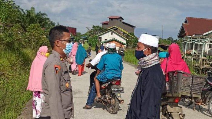 Personel Polsek Bika, Polsek Badau dan Polsek Jongkong Amankan Pelaksanaan Sholat Idul Adha 1442 H