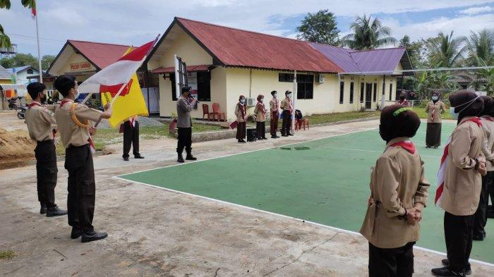 Panit Binmas Pimpin Apel Pelantikan Saka Bhayangkara Ranting Sebawi