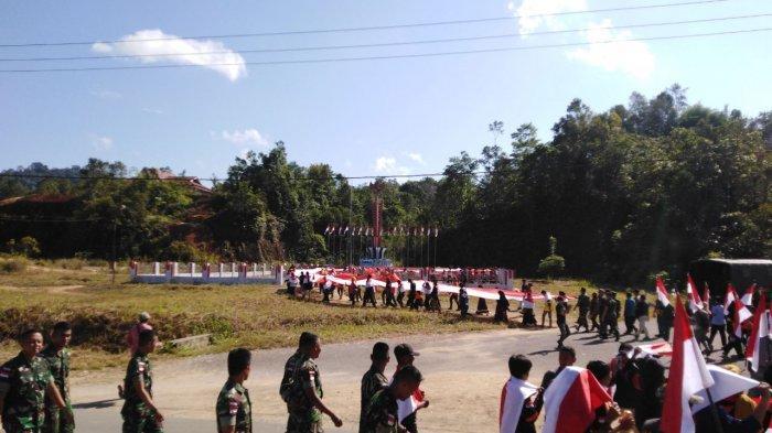 Satgas Yonmek 643/Wns Hiasi Perbatasan dengan Seribu Bendera Merah Putih