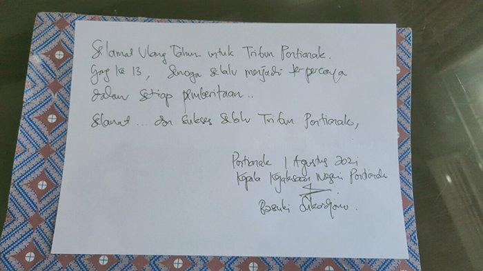 Tulisan tangan Kepala Kejari Pontianak Basuki Sukardjono berisi ucapan selamat ulang tahun ke 13 Tribun Pontianak.