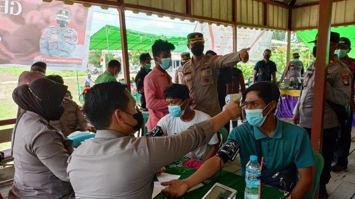 Kapolres Kubu Raya Hadiri Serbuan Vaksinasi Massal di Desa Radak Baru Kecamatan Terentang