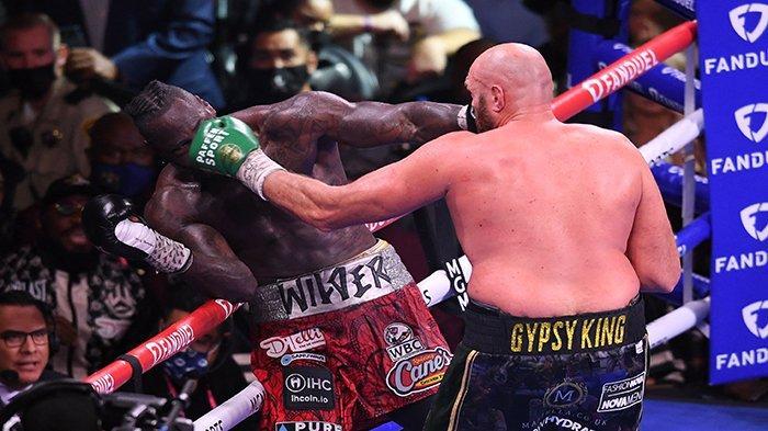 Hasil Tinju Tyson Fury vs Deontay Wilder, Pukulan Jab dan Straight di Ronde ke-11 Tumbangkan Wilder