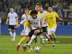 andrei-ratiu-leroy-sane-jerman-rumania-kualifikasi-piala-dunia-world-cup.jpg