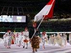 atlet-angkat-besi-nurul-akmal-membawa-bendera-indonesia.jpg