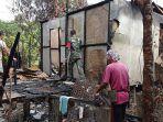babinsa-jagaoi-babang-bersama-warga-bersihkan-puing-sisa-kebakaran-selasa-19-januari-2021.jpg