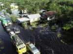 banjir-merendam-jalan-trans-kalimantan-desa-pancaroba-1.jpg