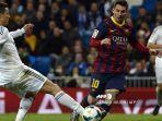 cristiano-ronaldo-dan-lionel-messi-dalam-sebuah-pertandingan-antara-real-madrid-vs-barcelona.jpg