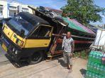 kondisi-truck-roda-enam-yang-nyaris-tumbang-karena-mengelakkan-pengendara-motor.jpg