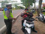 petugas-kepolisian-dari-satlantas-polres-kubu-raya-5353.jpg