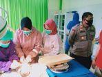 petugas-medis-saat-melakukan-perawatan-bayi-laki-laki-asd.jpg