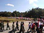 satgas-yonmek-643-hiasi-perbatasan-dengan-seribu-bendera-merah-putih.jpg