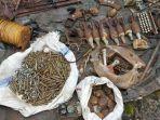sejumlah-senjata-api-laras-panjang-granat-mortir-dan-amunisi-ditemukan-warga.jpg