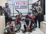petugas-polsek-cot-girek-aceh-utara-mengamankan-dua-tersangka-pencurian-sepeda-motor.jpg