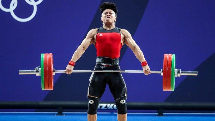 Jalani Debut di Olimpiade, Lifter Indonesia Rahmat Erwin Abdullah Langsung Puncaki Grup B