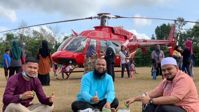 Pernah Jadi Pemulung, Pengusaha Sukses Malaysia Ajak Warga Naik Helikopter