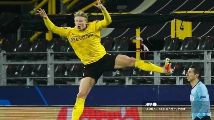 Penyerang Norwegia Dortmund, Erling Braut Haaland, merayakan gol 2-0 selama pertandingan sepak bola UEFA Champions League, babak 16 besar babak 16 besar BVB Borussia Dortmund v Sevilla FC di stadion Signal Iduna di Dortmund, Jerman barat pada 9 Maret 2021.