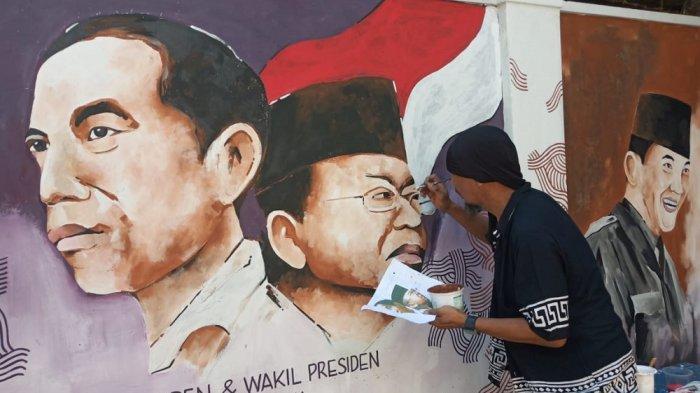 Euforia Warga Solo Jelang Pelantikan Presiden Joko Widodo, Ekspresikan Lewat Goresan Mural