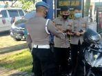 anggota-kepolisian-tak-miliki-sim-dan-surat-kendaraan-tak-lengkap-ditilang-sesama-anggota-polisi.jpg