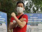 atlet-bulutangkis-indonesia-hendra-setiawan-usai-menjalani-vaksinasi-kedua.jpg