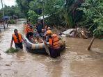 banjir-madiun-petugas-bpbd-tni-dan-polisi-berupaya-menyisir-perkampungan.jpg