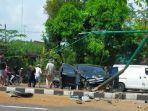 n-mobil-berwarna-hitam-seusai-kecelakaan-di-jalan-raya-so-sragen.jpg