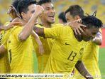 para-pemain-timnas-malaysia-berselebrasi.jpg
