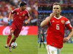 pemain-spanyol-diego-costa-dan-pemain-rusia-denis-cheryshev_20180701_164546.jpg