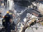 petugas-memeriksa-lokasi-jatuhnya-pesawat-menimpa-rumah-di-filipina_20180317_180949.jpg