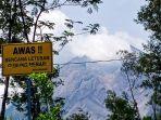 plang-tulisan-awas-bencana-letusan-gunung-merapi-terpasang-di-kawasan-objek-wisata-kali-talang.jpg