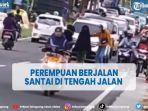 video-seorang-perempuan-berjalan-santai-di-tengah-bahu-jalan-viral-di-mediao-social.jpg