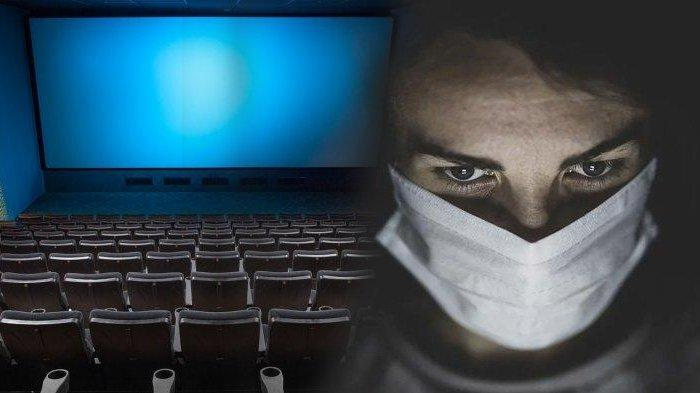 Ilustrasi memakai masker saat nonton film di bioskop.