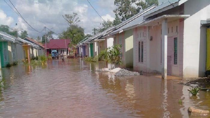 Ilustrasi perumahan kebanjiran.