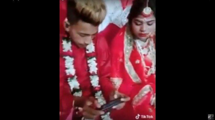 Pengantin Pria Dalam Acara Menikahnya Ini Kepergok Lebih Pilih Main Gim PUBG.