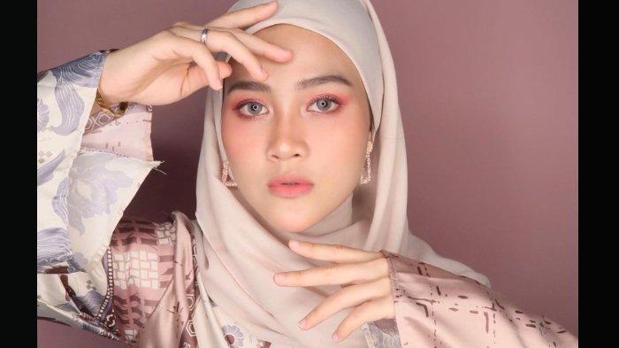 Profil Henny Rahman