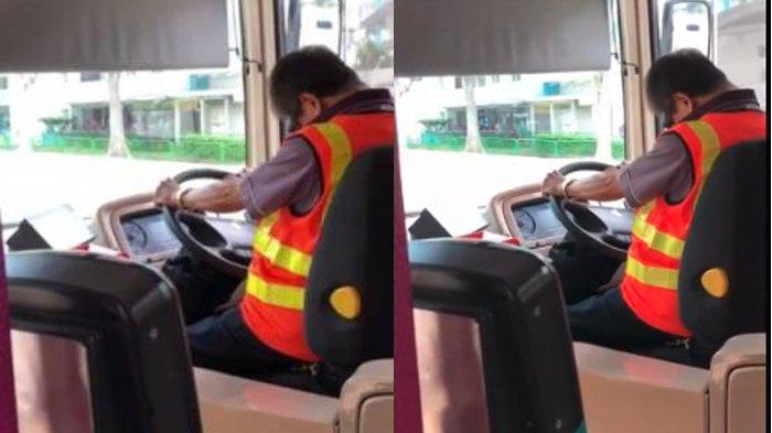 Sopir menundukkan kepala saat mengemudi