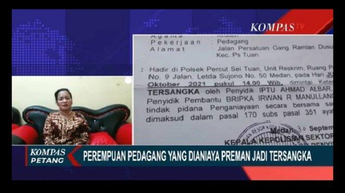 Pedagang perempuan yang dianiaya preman di Pasar Gambir Tembung, Deli Serdang, Sumatera Utara, justru ditetapkan sebagai tersangka oleh polisi.