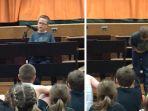 adam-kornowski-anak-kelas-4-bernyanyi-lagu-imagine-dari-john-lennon-menjadi-viral_20180607_203843.jpg