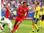 dele-alli-mencetak-gol-kedua-inggris-atas-swedia_20180707_230242.jpg