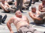 hukuman-punya-berat-badan-berlebih-polisi-di-thailand-harus-dikirim-ke-kamp-penghancur-perut-buncit.jpg