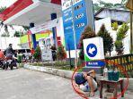 pedagang-bensin-eceran-jualan-di-spbu.jpg