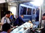 pelaku-bom-bunuh-diri-ra-22-dimasukkan-ke-dalam-ambulance.jpg