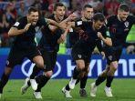 pemain-timnas-kroasia-merayakan-kemenangan-saat-melawan-tuan-rumah-rusia-di-ajang-piala-dunia-2018_20180713_150226.jpg