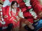 video-viral-pengantin-pria-dalam-acara-menikahnya-ini-kepergok-lebih-pilih-main-gim-pubg.jpg