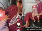 viral-pramugari-gendong-bayi-menangis-saat-penerbangan.jpg