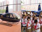 viral-pria-ini-kirimkan-helikopter-ke-sekolahan-anak-perempuannya-1.jpg